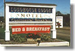 Longhouse Lodge Motel Sign